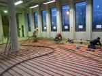 Cementdekvloer met vloerverwarming in realisatie